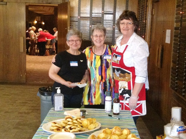 Betty Giffin (centre), VQC Founder, with two VQC volunteers